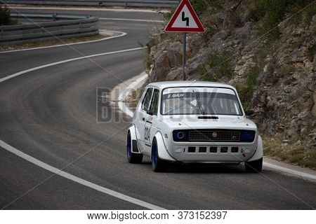 Skradin Croatia, June 2020 Simple White Old Fiat Modified For Hill Climb Racing Up Hill, Going Throu