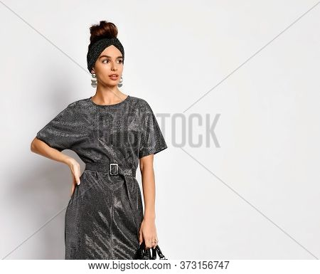 Charming Woman With Hair Styled In Updo Posing In Original Headband, Elegant Earrings And Charcoal D