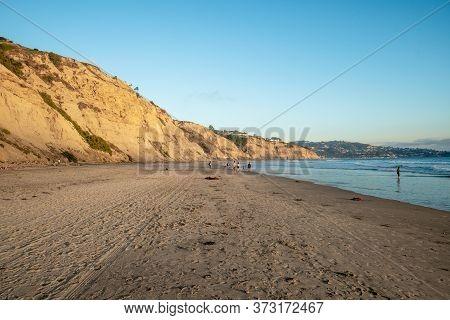 Pacific Coastline With Yellow Sandstone Cliffs Before Sunset Time. Black Beach, Blacks Beach, San Di
