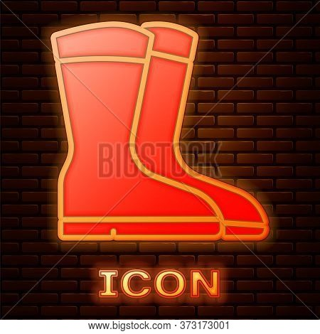 Glowing Neon Fishing Boots Icon Isolated On Brick Wall Background. Waterproof Rubber Boot. Gumboots