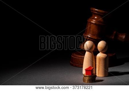 Divorse Property Division Concept. Wooden Family With House And Judge Gavel