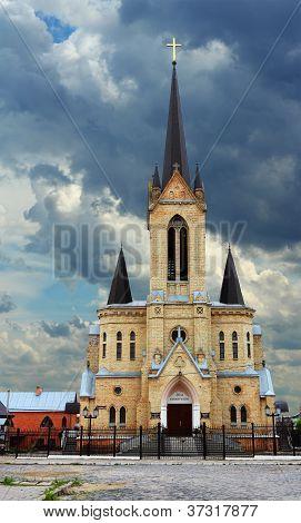 German Lutheran Church in Lutsk over dramatic sky,  Ukraine poster