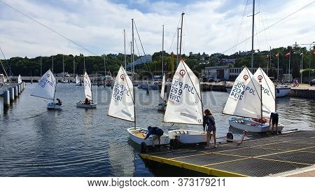 Gdynia, Poland - June 24, 2020: Sailing School. Children Learn To Sail On Small Boats.
