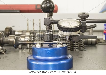 The Valve Of The Camshaft Drive Of The Internal Combustion Engine Is Installed In A Blue Device For