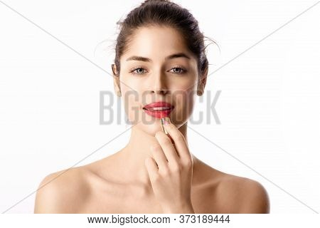 Beauty Shot Of Young Woman With Flawless Skin Wearing Red Lipstick While Posing At Isolated White Ba