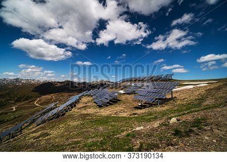 Solar Panel European Alps, High Altitude Landscape With Alternative Energy