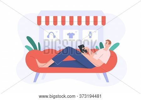 Online Shopping, Guy Lying On The Couch Surfing Internet, Making Purchase, E-shopping At Home, E-com