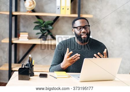 Video Call. Attractive African-american Guy Is Using Laptop For Video Communication, A Guy In Glasse