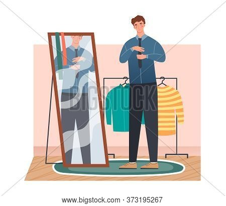 Man Getting Dressed In Front Of A Full Length Mirror At Home Tying His Necktie Looking At His Reflec