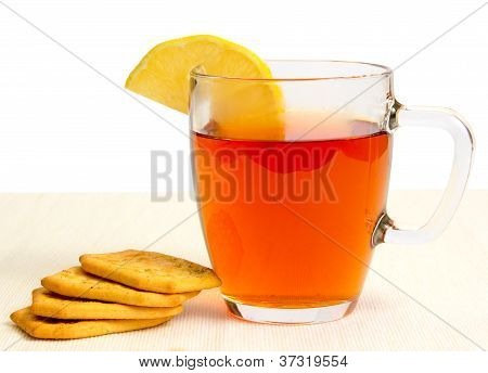 Glass Cup Of Tea With Lemon And Crackers