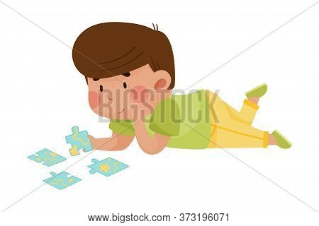Little Boy Lying And Putting Together Jigsaw Puzzle Vector Illustration