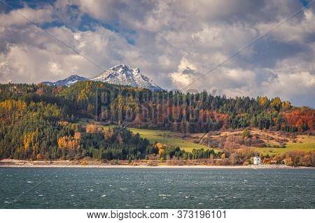A Snowy Hill Called Choc Over The Liptovska Mara Dam In Autumn Season, The Area Of Liptov In Slovaki