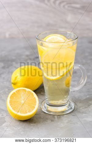 Refreshing Lemon Drink In A Glass On The Table. Alternative Medicine.