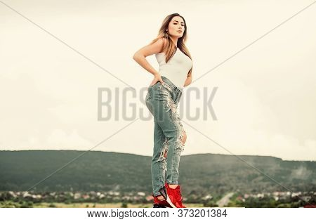 Fashion Girl. Stylish Sexy Girl Outdoors Sky Background. Daily Outfit. Developing Own Style. Forgoin