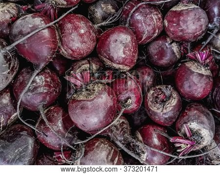 Unpeeled Raw Beets On A Market Counter. Background From The Same Vegetables. Farm Root Crops. Health