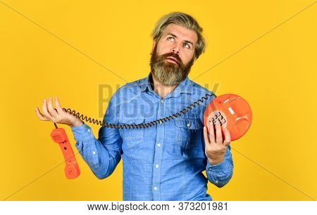 No Connection. Vintage Technology In Modern Life. Young Man Talking On Telephone. Senior Man Hipster