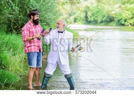 Fishing And Drinking Beer. Men Relaxing Nature Background. Fun And Relax. Weekend Time. Bearded Man