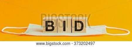 Health And Medicine With The Inscription Bid On Wooden Cubes, With The Medical Mask . Medicines For