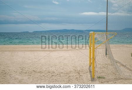 Empty Beach With Football Goal On A Sunny Day On The Sea And Blue Sky Background. Preparing The Beac
