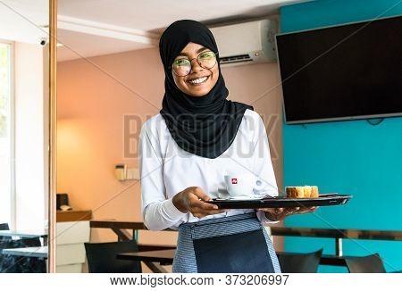 Male, Maldives - February 11th, 2019: Portrait Of A Muslim Woman Wearing Hijab And Eyeglasses Who Wo