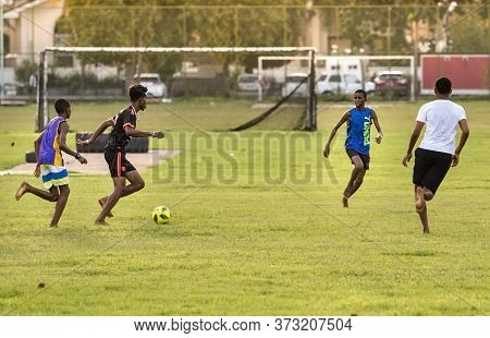 Victoria, Seychelles - February 3th, 2019: Young Men Playing Football Amateur Outdoors In Victoria,