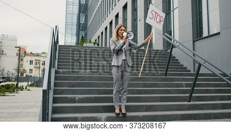 Single Protest Of Caucasian Woman In Glasses Talking And Screaming In Megaphone. Female Protestant H