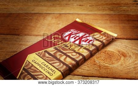 Chisinau, Moldova - April, 26, 2020: Nestle Kitkat Chocolate Bar, Biscuit, Break. Isolated On Wooden