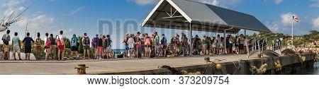 La Dique, Seychelles - February 4th, 2019: Queue Of People Waiting To Embark At The Pier Of La Digue