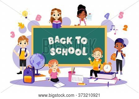 Back To School Concept. School Lesson. Little Students Sitting Around The Blackboard. Classroom With
