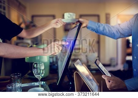 Selective Focus To Tablet And Blurry Customer Using Smart Phone Scan Qr Code On Tablet To Payment