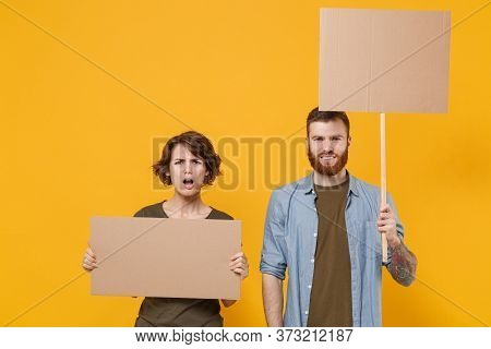 Puzzled Protesting Young Two People Guy Girl Hold Protest Signs Broadsheet Blank Placard On Stick Is