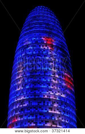 BARCELONA, SPAIN - AUGUST 15: Torre Agbar illuminated at night on August 15, 2012 in Barcelona, Spain. This 38-storey tower was designed by the famous architect Jean Nouvel