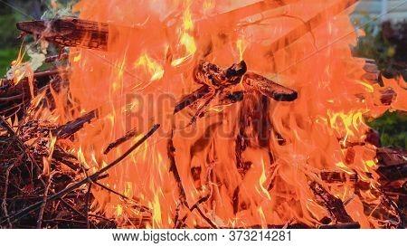 Huge Bonfire At Dusk. Close-up Of A Bonfire