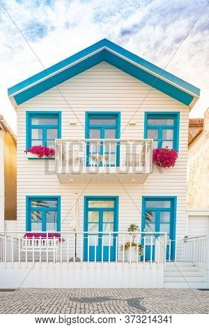 Colored Window And Balcony In Typical Small Wooden House With Colorful Stripes In Costa Nova, Aveiro