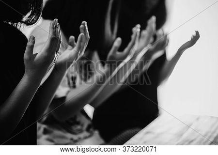 Black And White Of Group People Praying Worship Believe.