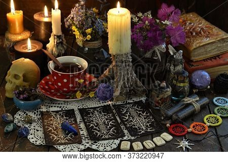 Still Life With Tarot Cards Layout, Burning Candles And Runes On Witch Table. Esoteric, Wicca And Oc