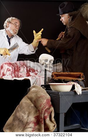 Evil Doctor Argues With Grave Robber Over Bloody Corpse