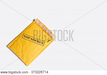 A Mailing Paper Bag For Letters Or Small Parcels With Text Top Secret On A Light Background. Secret