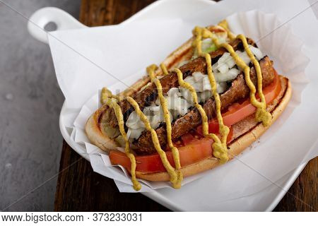 Vegan Hot Dog With Meatless Sausage, Onion And Tomato