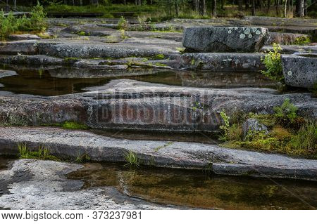 Park White Sea Petroglyphs In Karelia. Large Stones, Water And Forest. Beautiful Landscape.