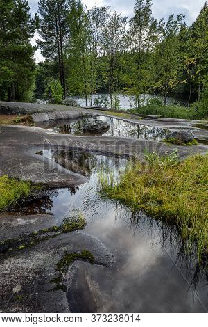 Park White Sea Petroglyphs In Karelia. Large Stones, Water And Forest. Beautiful Landscape. Vertical