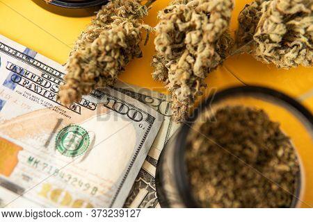 Joint Weed. Cannabis In Economics. Marijuana Weed Bud And Grinder. Money Weed. Indica Medical Health