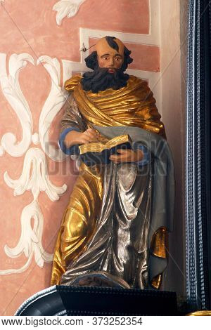 ZAGREB, CROATIA - MAY 16, 2013: Saint Mark the Evangelist, statue on the altar of the Holy Spirit in the Church of Saint Catherine of Alexandria in Zagreb, Croatia