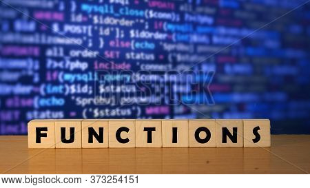 Functions Message Word On A Wooden Desk On Cube Blocks With A Software Development Background