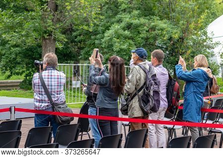 Moscow, Russia - August02, 2019: Group Of Photographers Taking Picture Together On An Open Air Festi