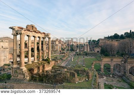 Cityscape Of The Roman Forum Ruins With The Arch Of Severus, Temple Of Saturn, Temple Of Vesta, Basi