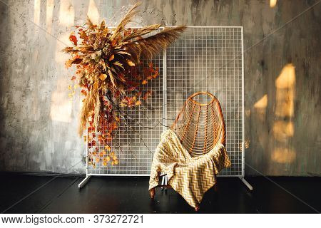Modern Interior With Wicker Chair And Pampass Grass