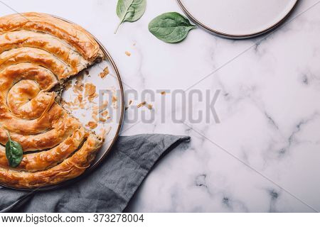 Filo Spinach And Feta Twist Pie In The Plate Freashly Baked At Home