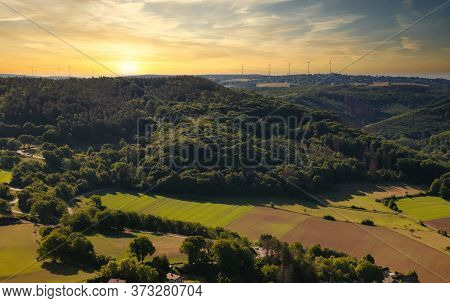 Picturesque Panorama Of Forests, Highlands And Meadows On The Background Of The Sunset. North Rhine-