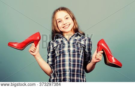 Glamour High Heels. Awesome Red Glossy Stiletto Shoes. Little Fashionista Kid With High Heels. Wish